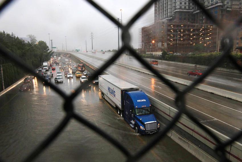 Drivers attempt to cross the floodwaters on Highway 59 in Houston on April 18, 2016.