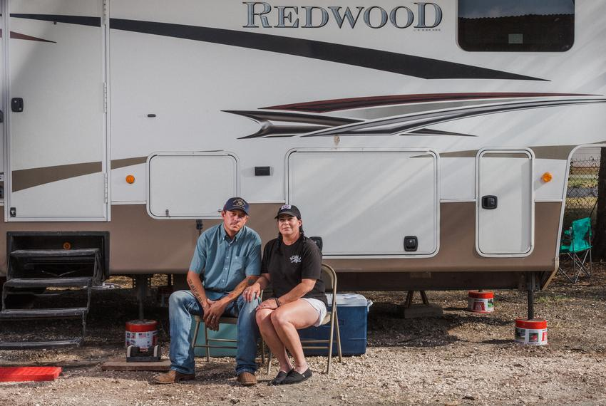 Elizabeth McNiel, the owner of Ironwood Saloon and an ASL teacher, and her husband Ryan front of their RV that is parked beh…