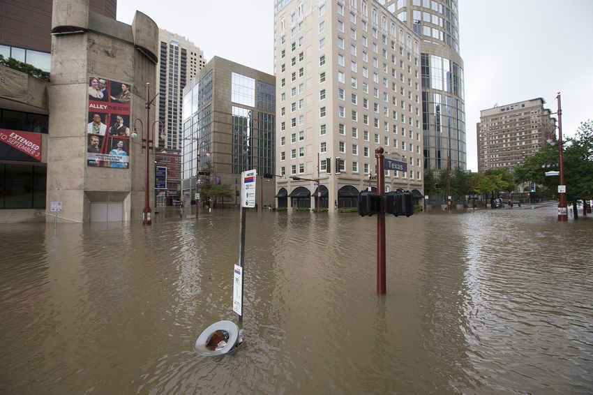 The Theater District in downtown Houston is flooded after Buffalo Bayou jumped its banks on Sunday, Aug. 27, 2017.