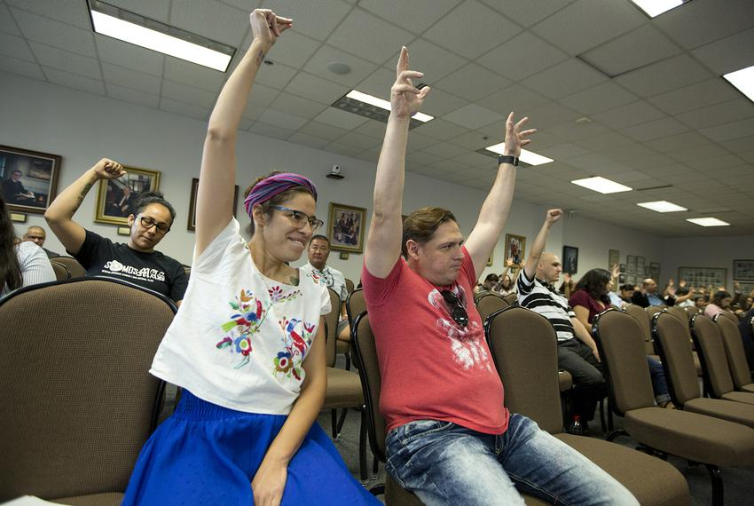 Devyn Gonzales and Gilberto Sanchez raise their arms in support of changing the name of a new course on Mexican-American h...