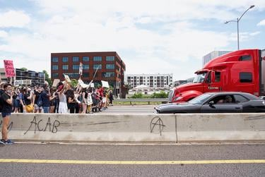 Protesters marched onto Interstate 35 and blocked traffic during a protest near downtown Austin.
