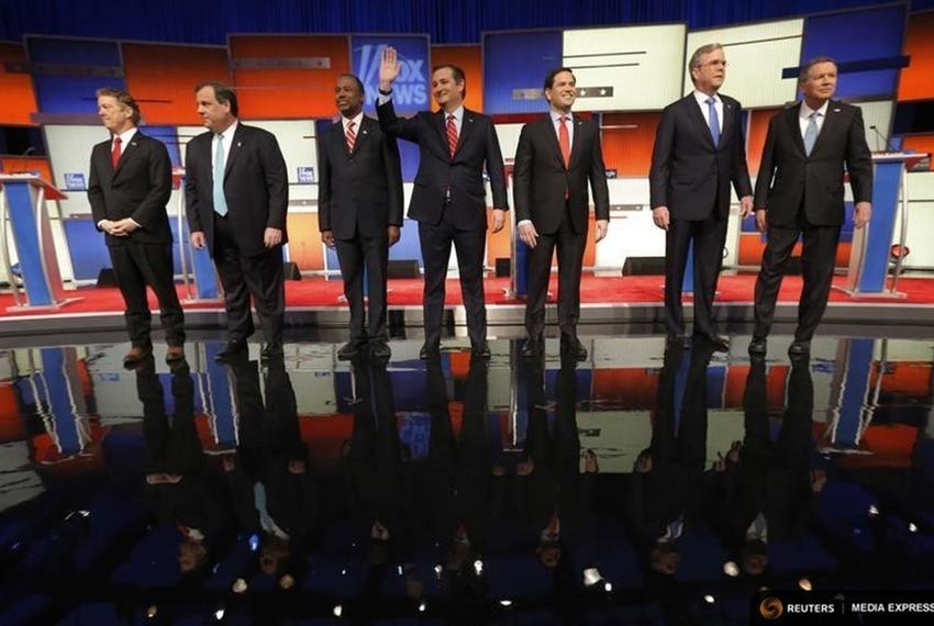 Republican U.S. presidential candidates pose together onstage at the start of the debate held by Fox News for the top 2016...