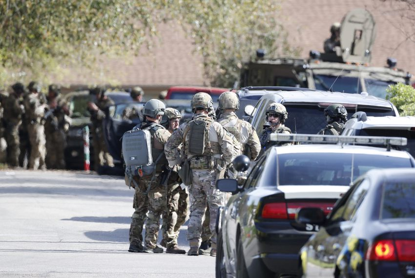 FBI agents and other authorities gather around the home of bombing suspect Mark Conditt in Pflugerville on Mar. 21, 2018.