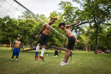 A group plays a Thai game of Takraw at White Rock Lake in Dallas on June 13, 2021. The group, who are all vaccinated, had no worries about playing their sport.