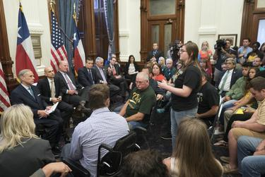 Santa Fe shooting survivor Grace Johnson spoke to Gov. Greg Abbott at a roundtable discussion on school safety and mental health issues last May at the Texas Capitol.