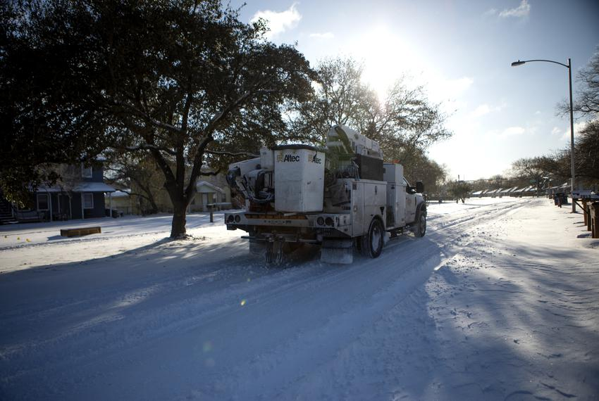 An Austin Energy truck heads eastbound on East Stassney Lane in Austin after a severe snowstorm hit Texas on Feb. 15, 2021.