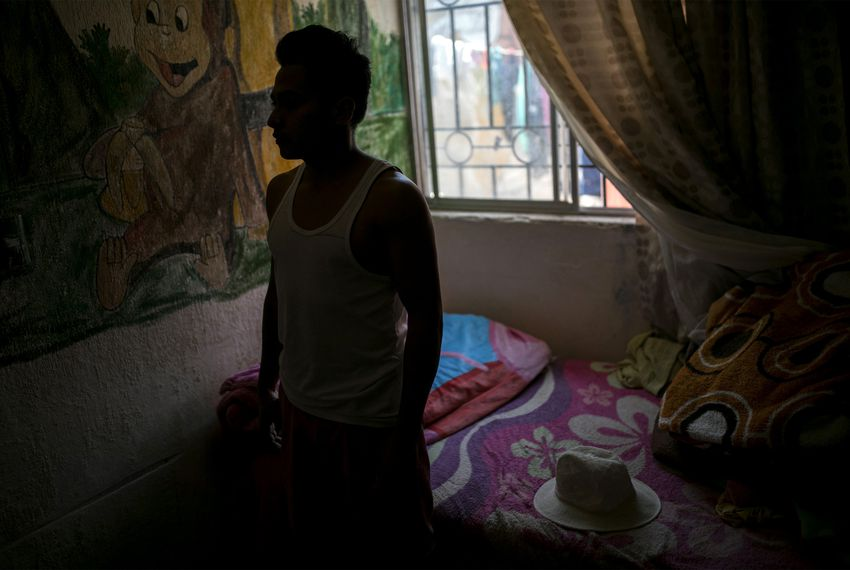 "A young man from Honduras who goes by ""Alexander"" at a house on the outskirts of Ciudad Juárez, where he has been living since he was sent back over the border as part of President Trump's ""Remain in Mexico"" program, on Friday, July 19, 2019."