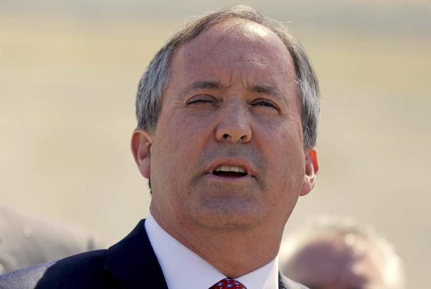 Attorney General Ken Paxton speaks outside the U.S. Supreme Court in 2016.