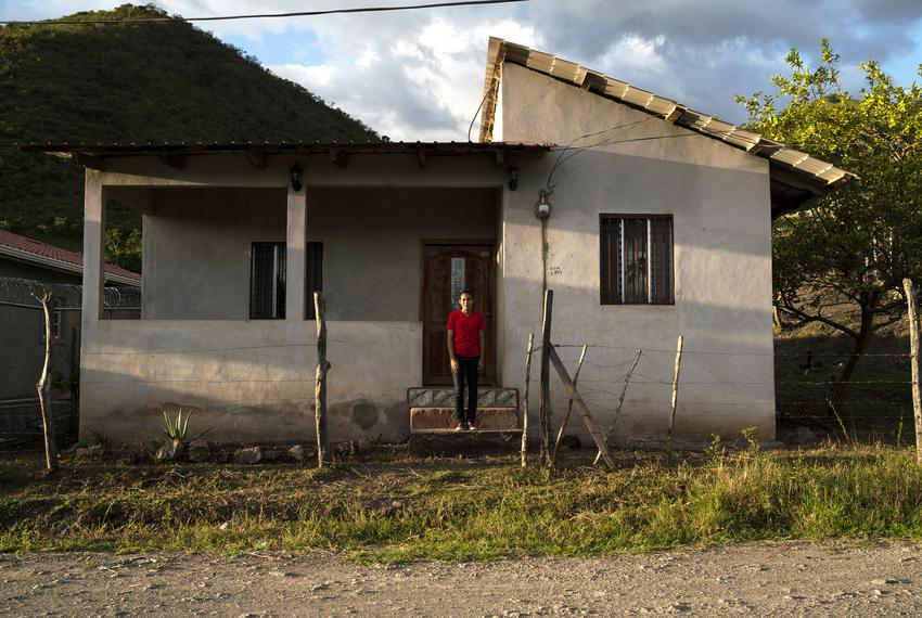 Claudia poses for a photo outside of the house that she and her husband Carlos rented in Olancho, Honduras. Claudia says tha…