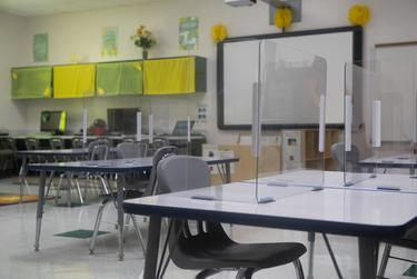 Plastic partitions are set up on a desk at Premont Ernest H. Singleton Early College Academy on Tuesday, Aug. 4, 2020 in Premont.