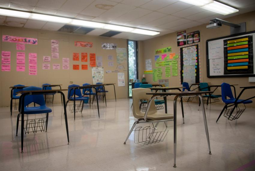 Desks are seated six feet away from each other at Premont Collegiate High School on Aug. 4, 2020 in Premont. Some desks, m...