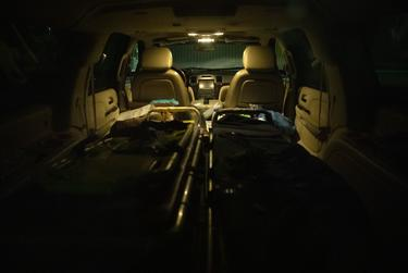 Two hospital stretchers lay in the back of Juan Lopez's Cadillac Escalade. Lopez uses the vehicle to pick-up and deliver cadavers to local funeral homes. Because of COVID-19, Lopez has seen a surge in calls and bodies. July 17, 2020.