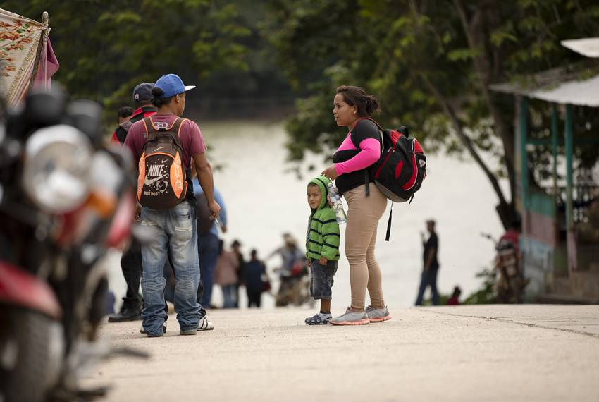 A group of migrants stop near a restaurant in La Tecnica, Guatemala. The group had recently exited a bus that arrived to L...