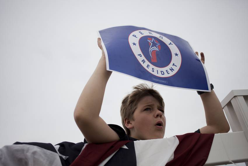 Joseph Johnson, 10, of Webster County, cheers for Perry.