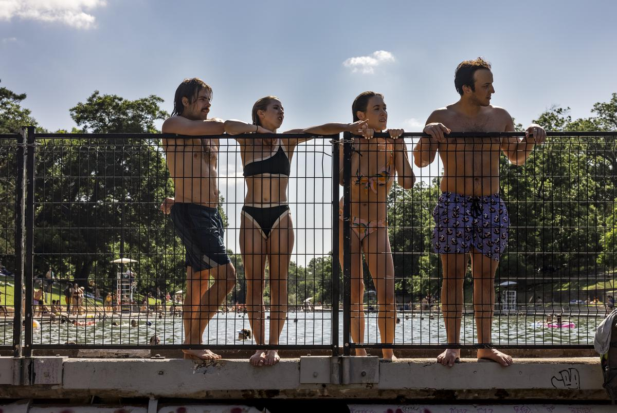People at Barton Springs Pool watch a concert on Friday, June 11, 2021.