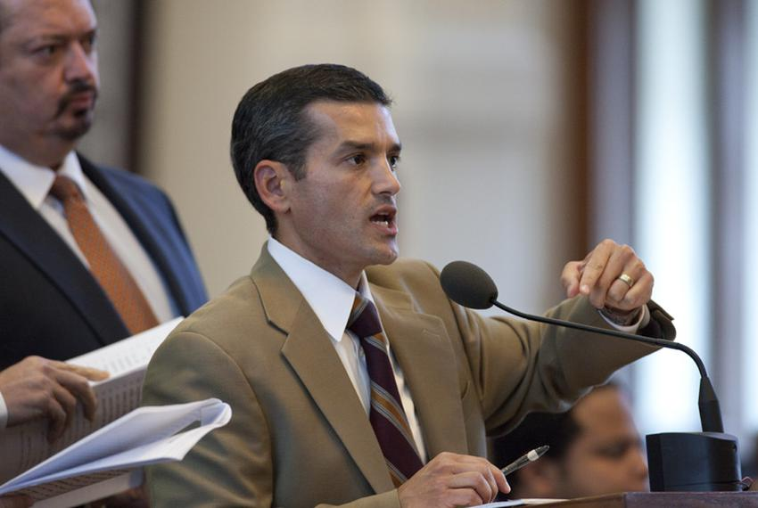 State Rep. Mike Villarreal, D-San Antonio, questions House sponsor Jim Pitts from the back microphone as debate on SB1811 be…