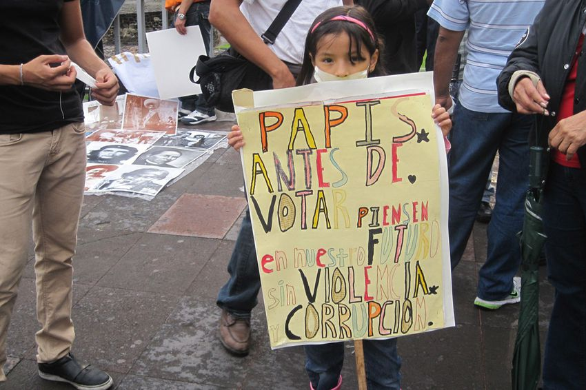 A young Mexican child at a YoSoy132 protest in Mexico City's Plaza de Las Tres Culturas. The sign pleads for voters to think of the child's generation when casting their ballots.