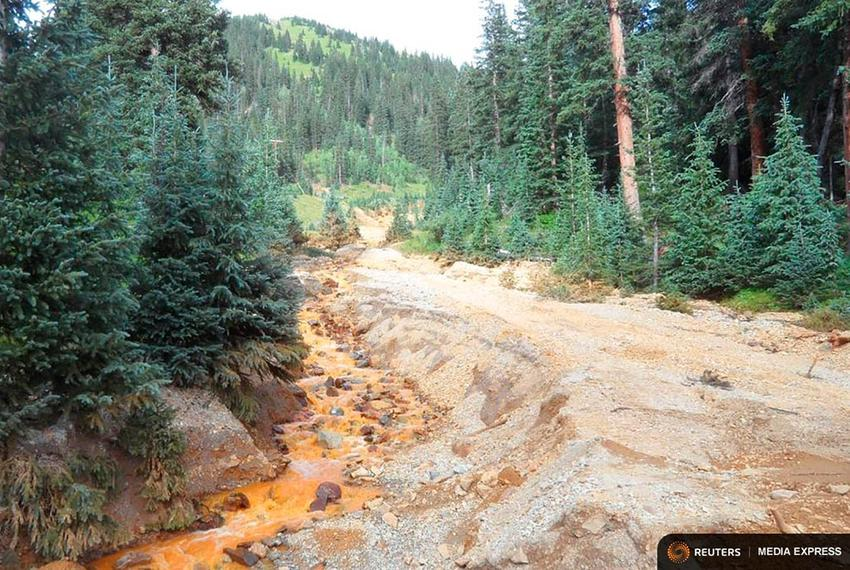 Yellow mine waste water from the Gold King Mine is seen in San Juan County, Colorado, in this picture released by the Enviro…