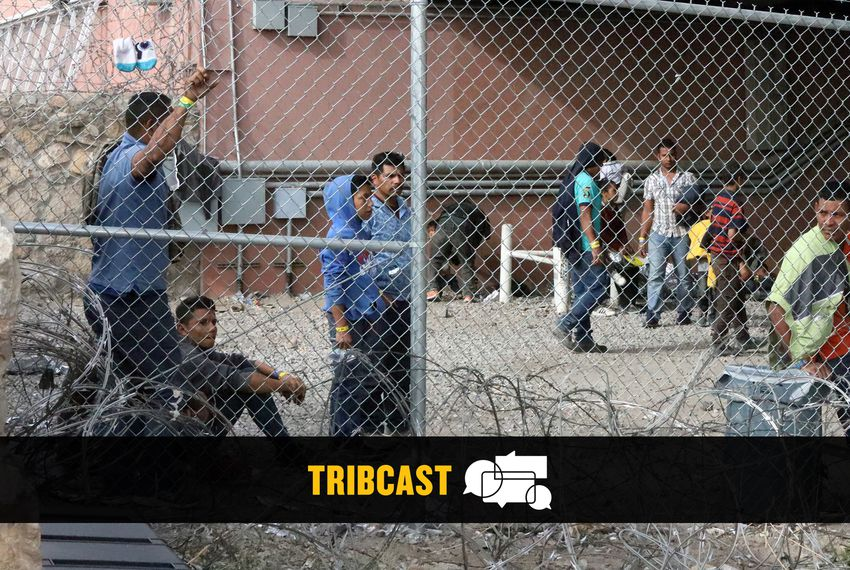 A group of migrants waited inside a holding area under the Paso Del Norte bridge last month.