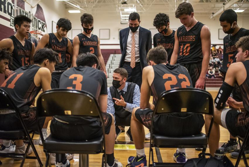 Westwood High School head coach Brad Hastings speaks to his team during a time out during a basketball game at Round Rock Hi…
