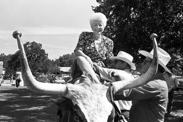 """Ann Richards on longhorn, 1988.  Newton was 200 yards away photographing an event with the state's slate of Democratic candidates when he saw then-state treasurer Ann Richards sitting on a longhorn steer. He grabbed his cameras and ran toward her.  """"All I know is I turn around and Ann was sitting up there — they just put her up there. She saw me running and said, 'Scott, don't you dare take my picture,'"""" he said.  This image, he said, conveyed Richards at her best.  """"She was a hoot. She was not only the best politician I ever shot as far as understanding what it is you needed and providing it for you,"""" he said. """"She is just naturally a hilarious person."""""""