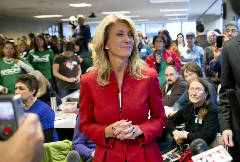 State Sen. Wendy Davis, D-Fort Worth, greeting supporters at a phone bank in Austin.