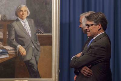 "On August 2, 2017, U.S. Energy Secretary Rick Perry presided over the unveiling of an oil portrait of his predecessor, Ernest Moniz. The painting highlights some of Moniz's published work, including a seminal study, ""The Future of Natural Gas."""