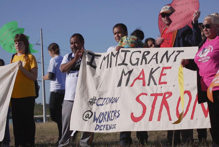 Immigrants and activists participate in press conference and rally on Nov. 19, 2015, before a 37-mile march to show suppor...