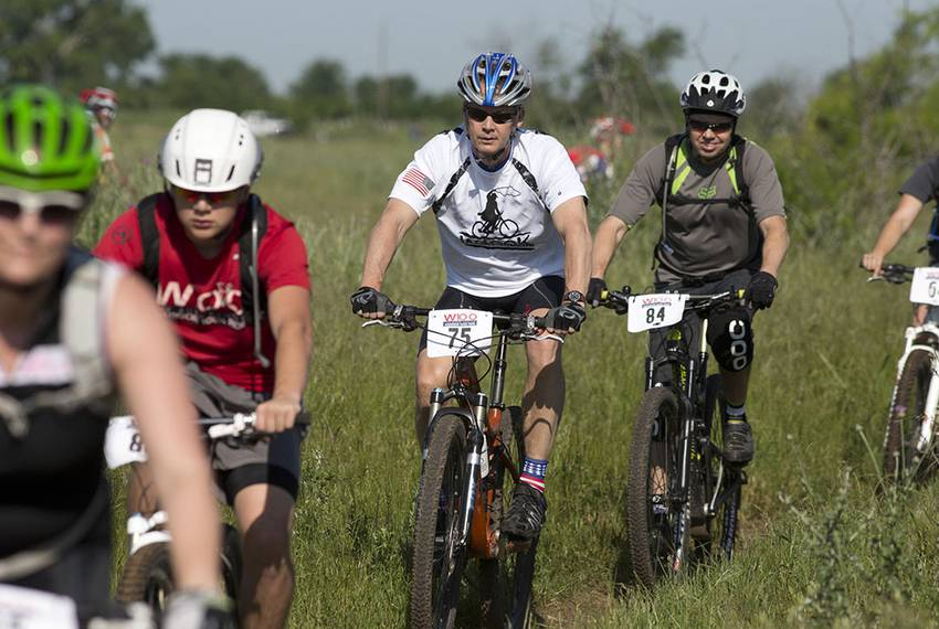 Riders make their way on the first day of their 100-kilometer ride at former President George W. Bush's ranch near Crawfor...