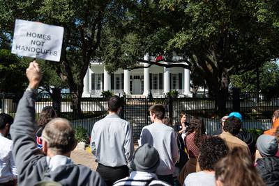 The Homes Not Handcuffs coalition leads a rally in front of the Texas Governor's Mansion in Austin on Saturday.