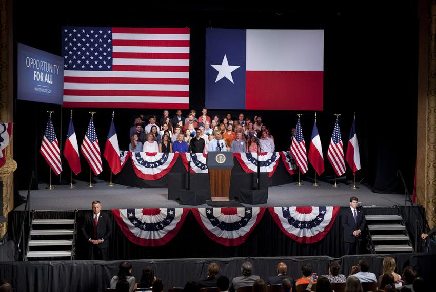 President Barack Obama speaks on the economy at the Paramount Theater in Austin July 10, 2014, following a two-day swing t...