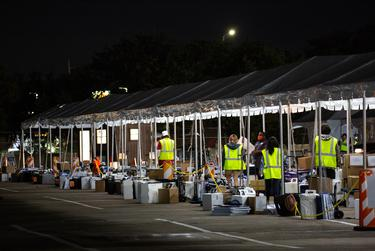 Harris County election workers process the election materials dropped off at the NRG Arena in Houston on Nov. 3, 2020.
