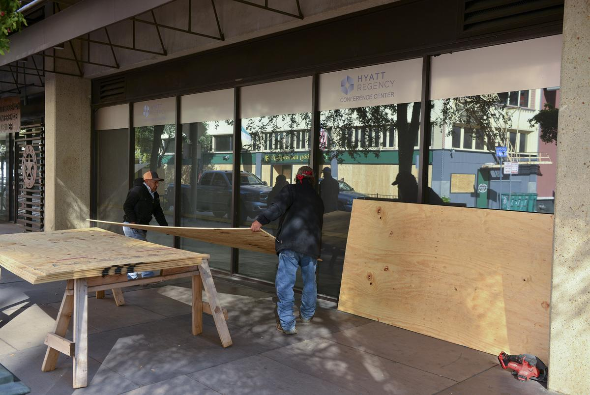 Workers unload sheets of plywood to board up a downtown San Antonio building in the event of civil unrest as a result of the election. Nov. 3, 2020.