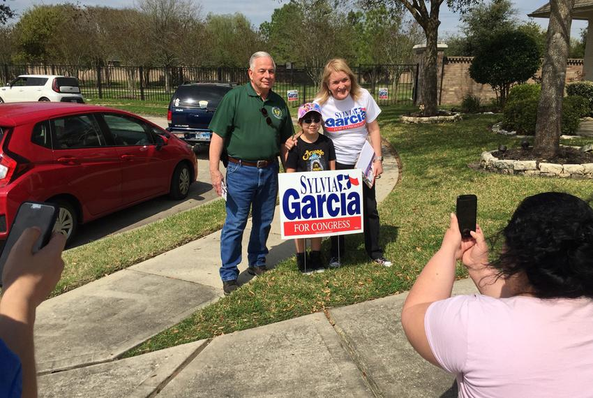 U.S. Rep. Gene Green and state Sen. Sylvia Garcia pose for a photo in Humble as they knock on doors for her congressional ca…