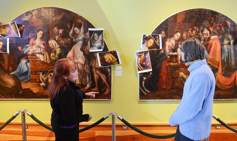 At the San Angelo Museum of Fine Arts, Mary Fredrickson, left, an art conservator, discusses restoration work she's doing with Laura Huckaby, the museum's collections manager.