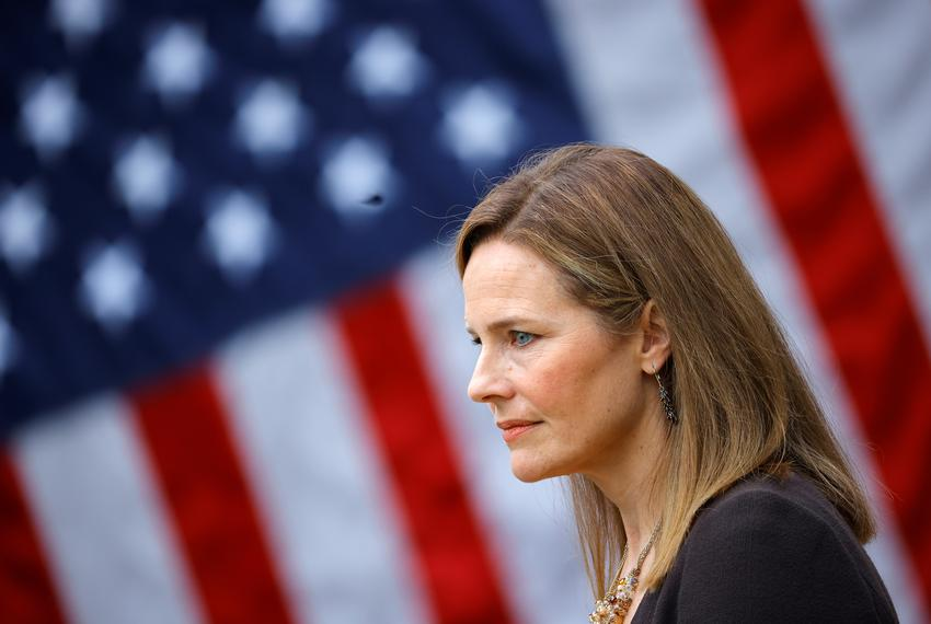 U.S. Court of Appeals for the Seventh Circuit Judge Amy Coney Barrett looks on as President Donald Trump announces her as hi…