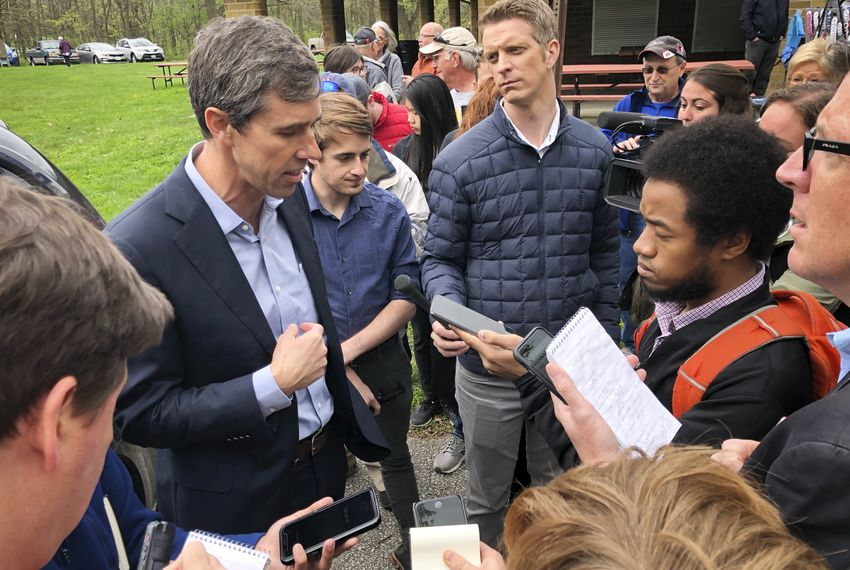 Beto O'Rourke talks to reporters in Shenandoah, Iowa, during his third visit to the Hawkeye State as a presidential candidate. O'Rourke is staking the latest stage of his campaign on a plan he released last week to fight climate change.