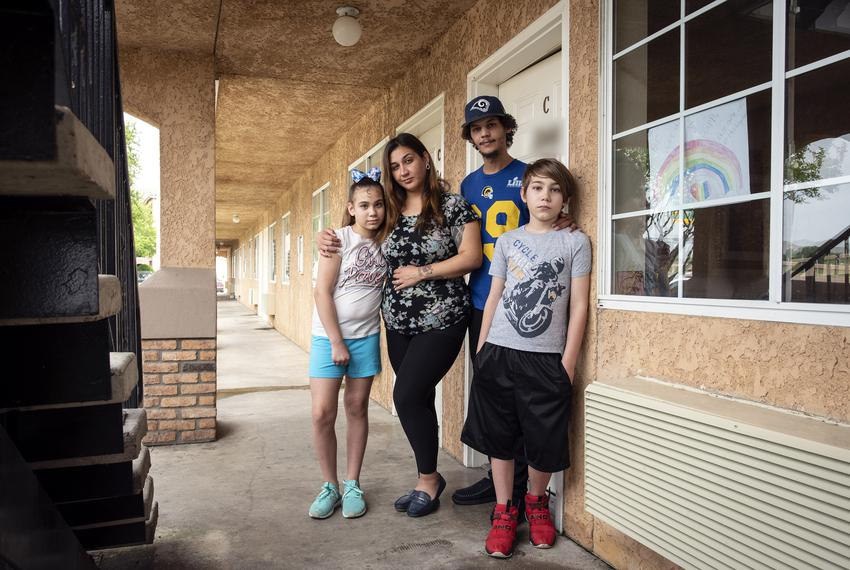 From left: Paetun Beavers, 11, her mother Tie Hernandez, Andre Cameron and their son Kingstun Beavers, 9, outside their room…