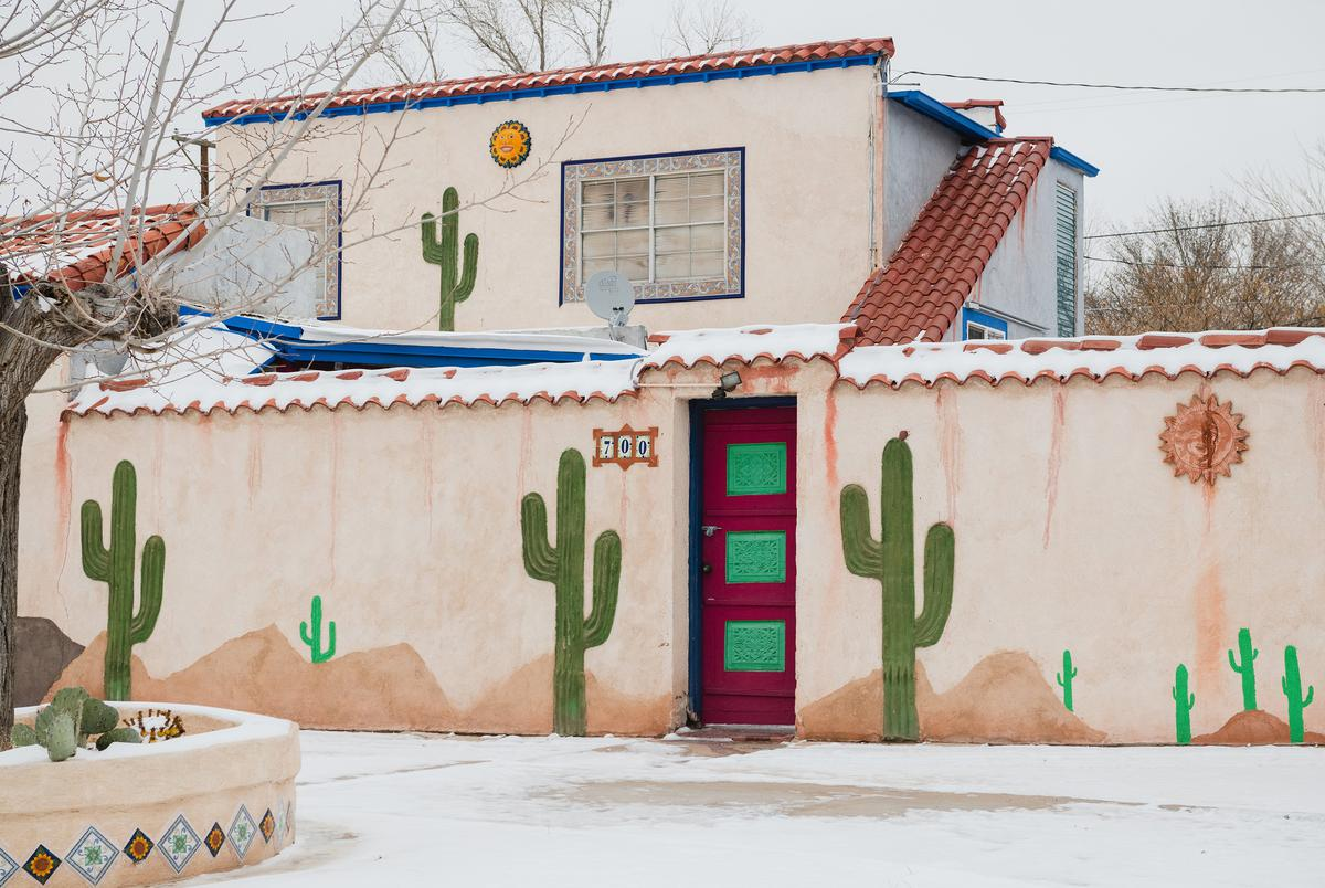 A house painted with cacti is covered in snow and ice in El Paso, Texas on February 15, 2021.