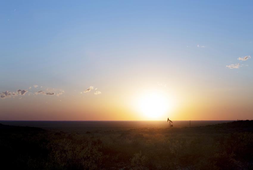 Looking west, a lone pump jack sees the sun dip below the horizon Saturday April 11, 2020 as oil prices continue to drop, ca…