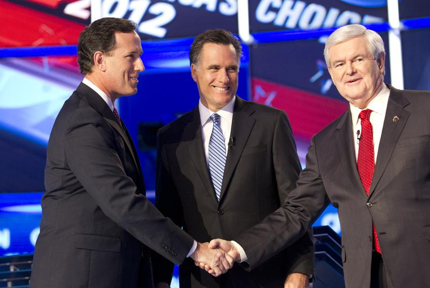 Rick Santorum, left, shakes hands with Newt Gingrich, right, and Mitt Romney watches as the three candidates meet onstage ...