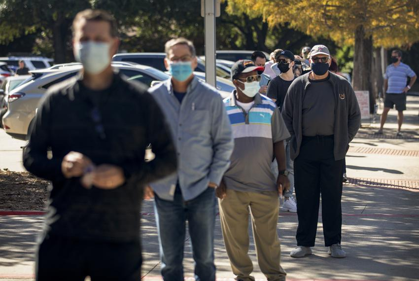 Voters wait in line to at Audelia Road Branch Library on the first day of early voting in Dallas on October 13, 2020.