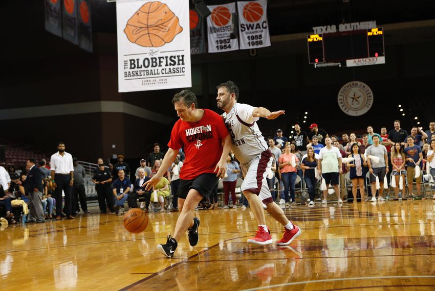 U.S. Sen. Ted Cruz, R-Texas, drives to the basket against late-night TV host Jimmy Kimmel in their one-on-one showdown Saturday in Houston. The game benefited charity.
