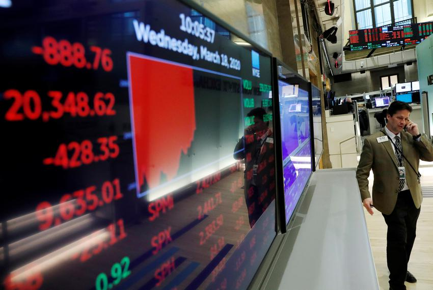 A screen at the New York Stock Exchange shows the day's numbers as markets continue to react to the coronavirus disease on...