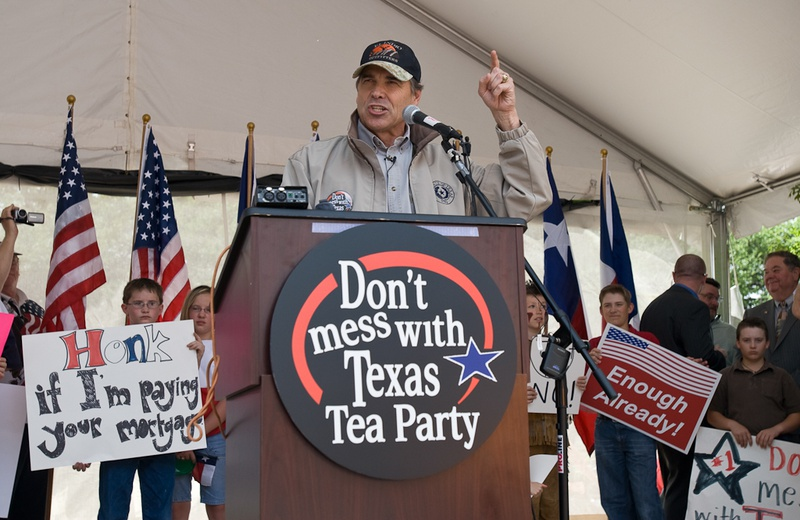 """Texas Gov. Rick Perry addresses a crowd estimated at 1,000 at a tax day """"tea party"""" April 15 at City Hall to protest federal government stimulus programs"""