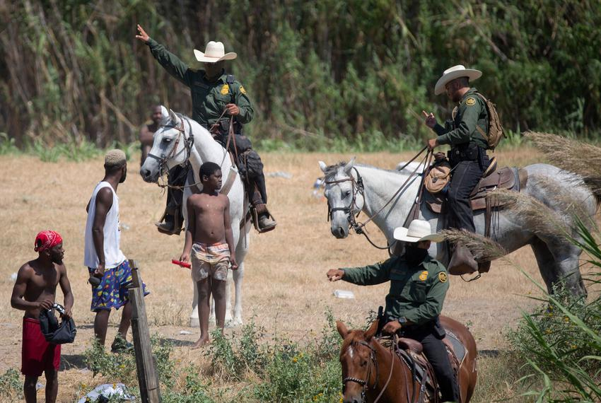 U.S. Border Patrol agents on horseback agents detered Haitians from returning to the U.S. on the bank of the Rio Grande afte…
