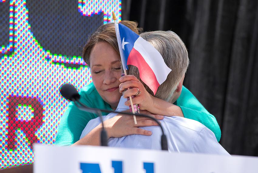 Cecelia Abbott hugs her husband, Attorney General Greg Abbott after he announces his plans to run for governor of Texas du...