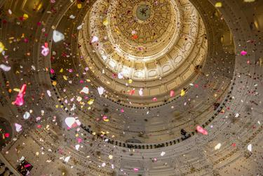 """Youth activists deploy over 200,000 rose petals from the capitol rotunda to protest against what they describe as """"Extremist Voter Suppression Legislation,"""" currently making its way through the elections committee in the Texas House of Representatives, on April 8, 2021."""