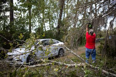 Robert Sepulvado clears debris off the road caused from Hurricane Laura in Orange on Aug. 27, 2020.