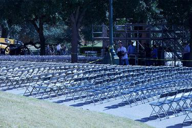 Shown the day before Abbott and Patrick were inaugurated, an ocean of seats surrounded the podium.